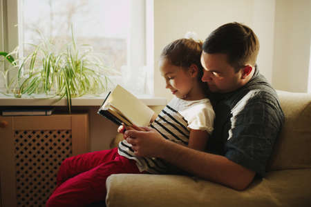 photo of father with daughter at home