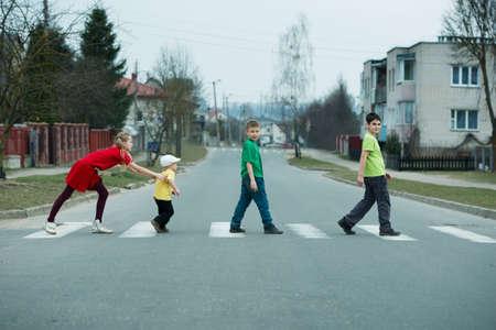 paso de cebra: photo of children crossing street on the crosswalk