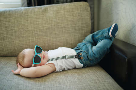cute little boy in sunglasses at home Stock Photo