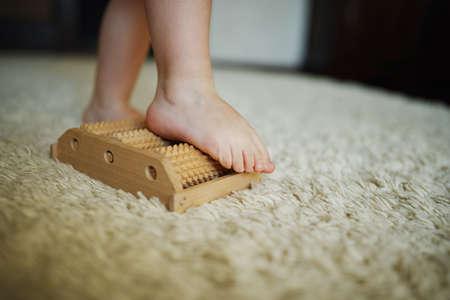 touching toes: little happy boy massage feet on massager
