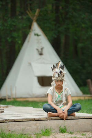 native american baby: photo of little funny boy with native american costume
