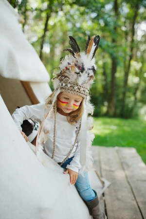 native american baby: photo of little funny girl with native american costume