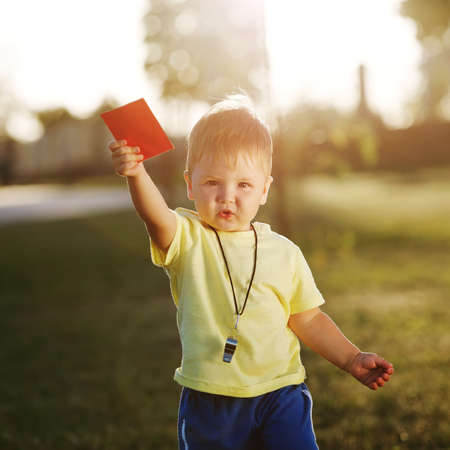 arbiter: photo of cute little referee with red card Stock Photo