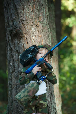 female assassin: little girl in camouflage suit with rifle