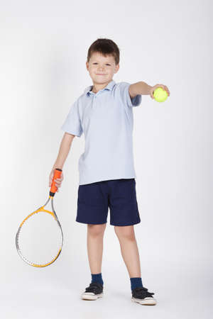 male tennis players: photo of little boy with racket and balls Stock Photo