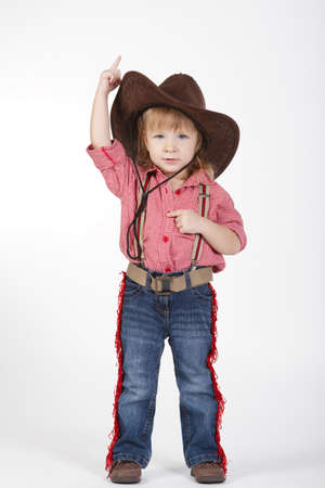 cowgirl and cowboy: photo of little funny cowgirl on white background Stock Photo