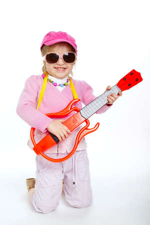 hardcore: little blond girl playing electric guitar hardcore