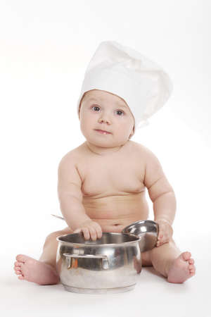 photo of little cute cook on white background