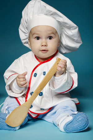 cute babies: photo of cute little baby with chef hat