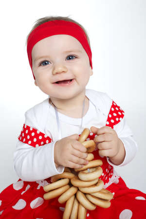 historical periods: photo of cute little girl with bread-rings Stock Photo