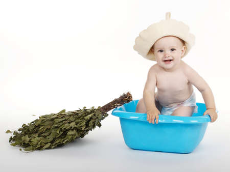 finland sauna: little boy with bath hat and broom
