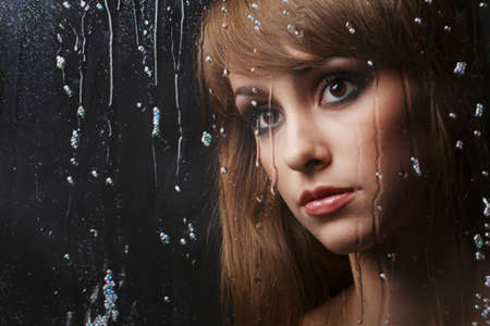 color model: studio photo of beautiful young girl on dark background