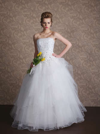 photo of young beautiful bride in wedding dress Standard-Bild