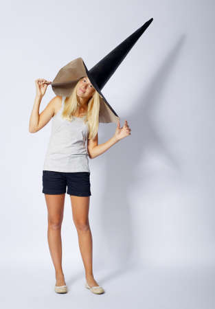 wizard hat: photo of beautiful girl with funny wizard hat