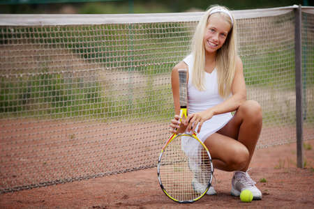 photo of beautiful young girl tennis player