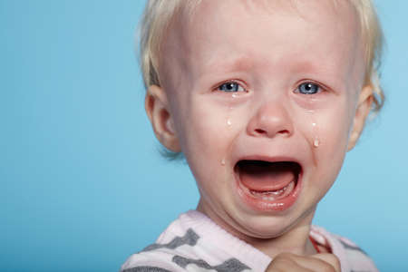 photo of little cute child with tears on face Stock Photo