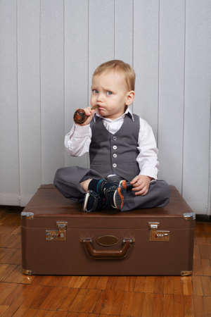 pipe smoking: photo of little funny boy with smoking pipe