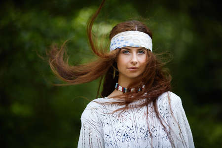 ethno: Beautiful hippie girl with long hair. Boho fashion style Stock Photo