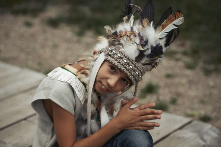 native american baby: Photo of little funny boy playing native american