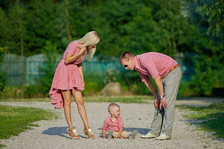 parenting: photo of young family parenting naughty son Stock Photo
