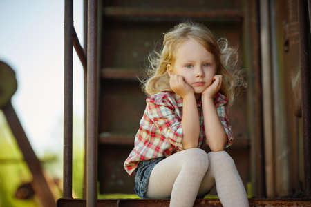 children clothing: little beautiful girl with long hair posing