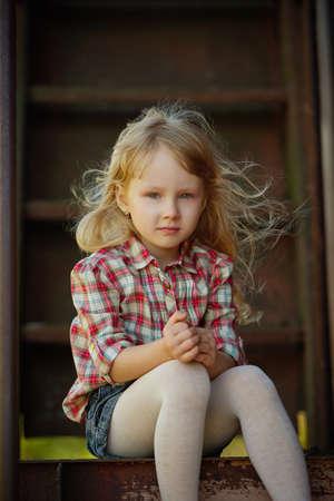 little beautiful girl with long hair posing