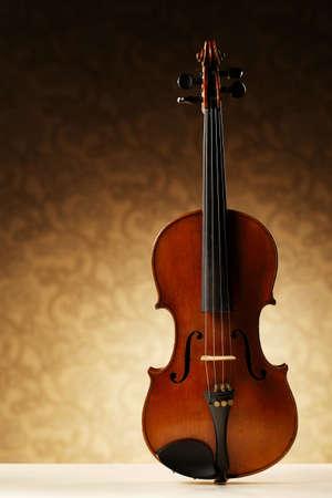 musical score: aged handmade violin on bright beige background