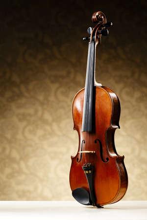 stradivarius: aged handmade violin on bright beige background