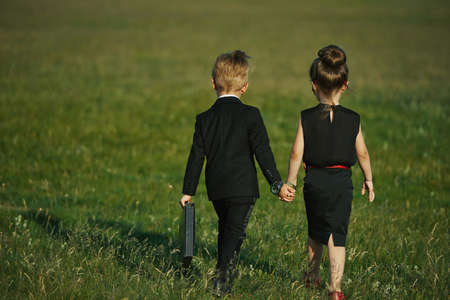 spy girl: photo of young boy and girl playing spy Stock Photo