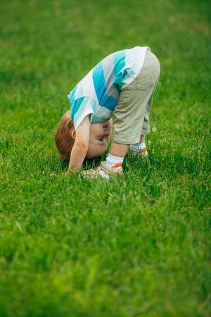 upside: photo of little boy looks upside down