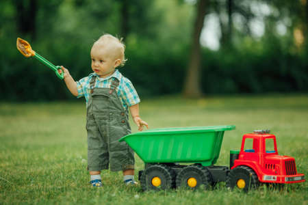 hand shovels: photo of little funny constructor with shovel