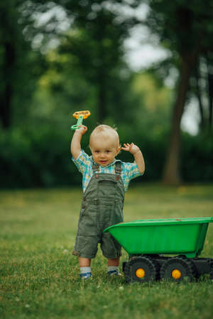 constructor: photo of little funny constructor with shovel