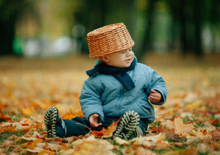 autumn colors: photo of cute little boy in autumn park