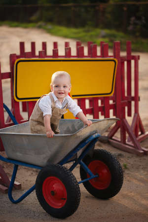 repaired: photo of little boy on the repaired road