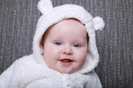 photo of baby in white bear costume