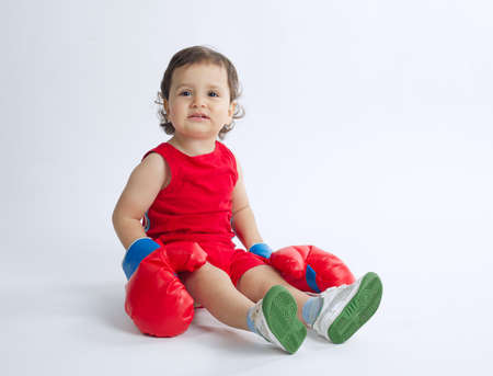 boxing boy: photo of cute little boy with boxing gloves Stock Photo