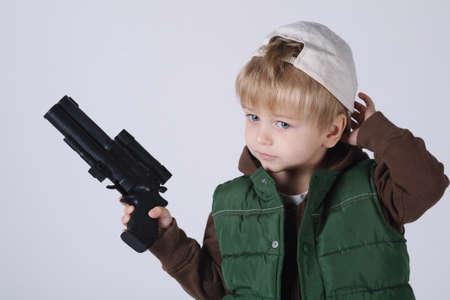 kids toy: photo of little boy with gun on white