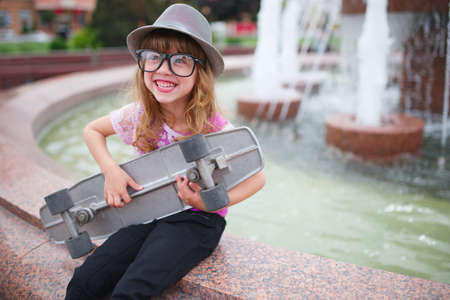 photo of little hipster girl with big glasses