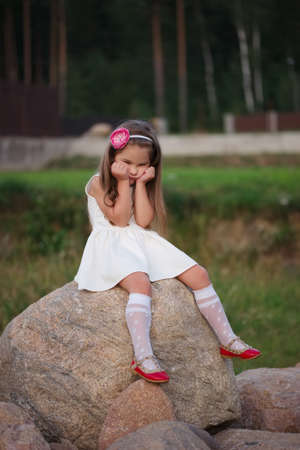 standing stone: cute little girl on the big stone