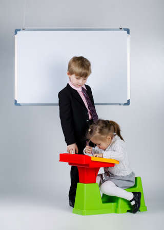 photo of young boy teaching younger sister Stock Photo