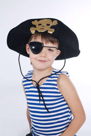 hook up: little boy in pirate costume on white background