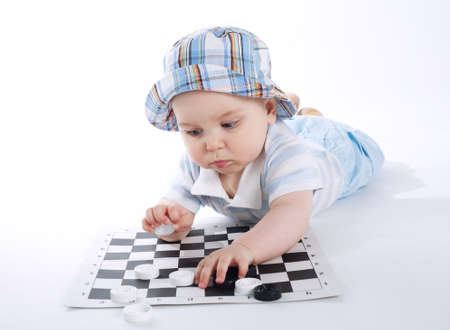 checkers: photo of cute baby playing checkers on white
