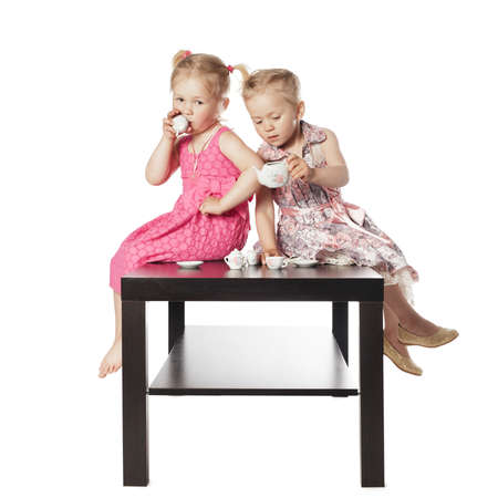 Kids playing tea ceremony on white background