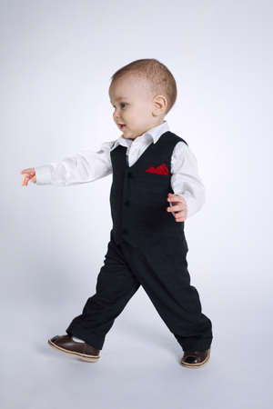 photo of cute little boy with suite