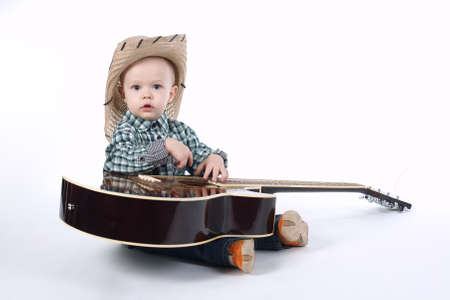 single songs: little boy plays guitar on white background