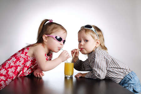 boy and girl drinking juice Stock Photo