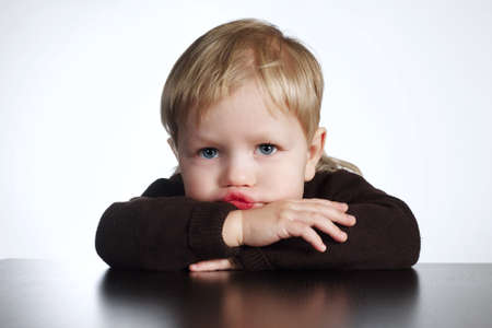 cute little bored boy on white background Stock Photo