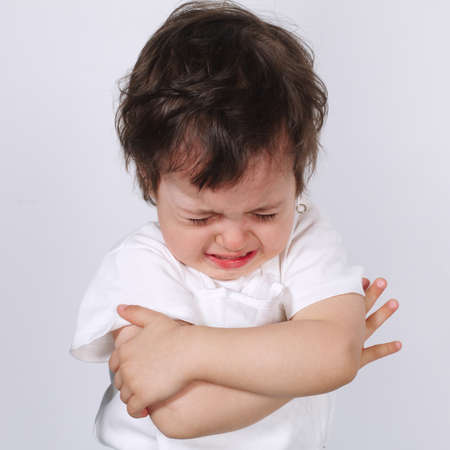 tantrums: cute crying boy on white background