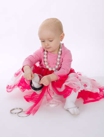 little girl wearing bracelet on feet