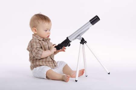 little boy with telescope exploring stars